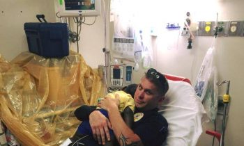 It Had Nothing To Do With The Badge: Officer Comforts Crying Toddler In Emergency Room