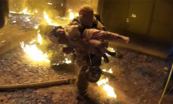 Video Shows Firefighter Catch Child Thrown From 3rd Story Balcony During Apartment Fire