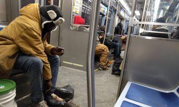 Man Gives The Boots Off His Feet To A Homeless Man On The Subway
