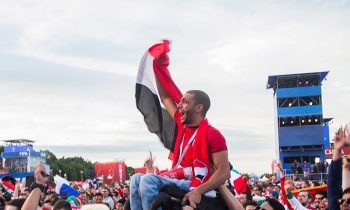 Egyptian Fan Is Lifted By Mexican And Colombian Fans So He Can See His Team Play