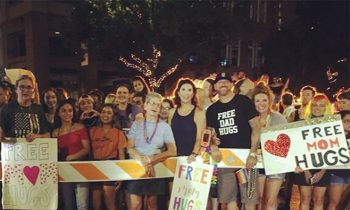 Church Gives and#039;Free Mom Hugsand#039; And and#039;Free Dad Hugsand#039; At Austin Pride Parade